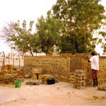 Atoumane building my first hut